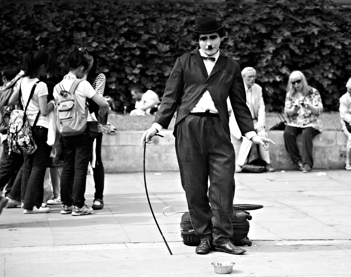 Charlie Chaplin impersonator in London by photographer Del Manning
